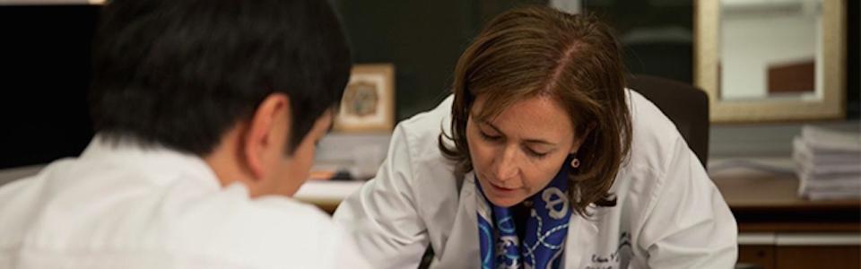 Dr. Erica Jones reviews the EKG report with patient.rsonalized treatment plan.